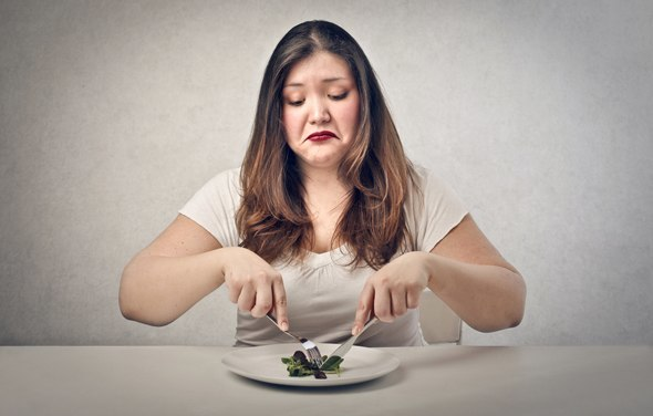 overweight-woman-eating-salad